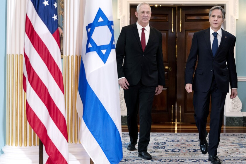 Secretary of State Antony Blinken, right, walks with Israel's Defense Minister Benny Gantz, Thursday, June 3, 2021, at the State Department in Washington. (AP Photo/Jacquelyn Martin)