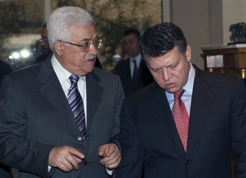 In this photo released by the Jordan Royal Palace, King Abdullah II of Jordan, right,  receives Palestinian President Mahmoud Abbas, left, in Amman, Jordan, Sunday, Jan. 11, 2009. (AP Photo/Jordan Royal Palace, Yousef Allan)