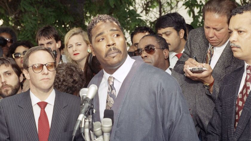 Rodney King speaks during a news conference in Los Angeles pleading for the end to the rioting that plagued the city in 1992 after four police officers were found not guilty beating case. Attorney Barry Kowalski later won convictions against two of the officers.
