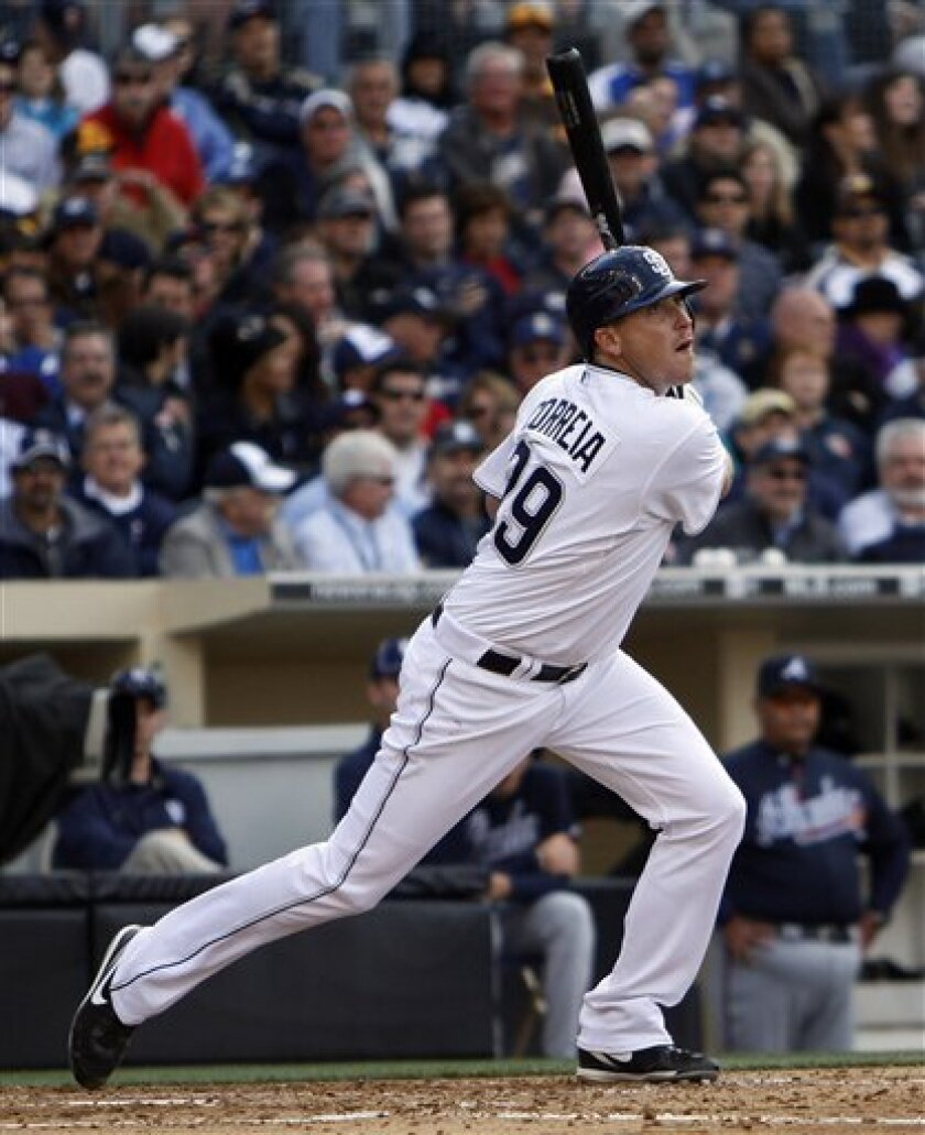 San Diego Padres pitcher Kevin Correia watches his bases loaded bloop single head down the right field line during the Padres' 10-run fourth inning against the Atlanta Braves during a  baseball game Monday April 12, 2010 in San Diego. (AP Photo/Lenny Ignelzi)