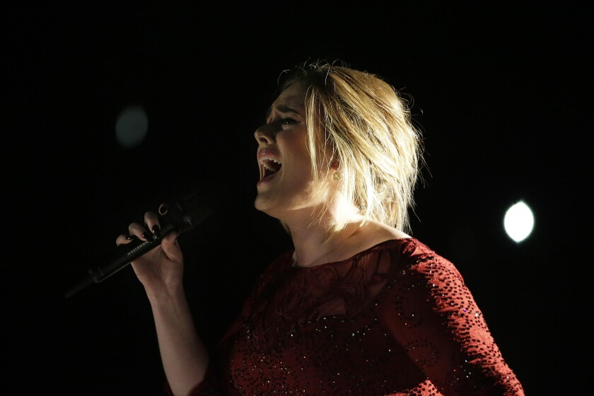 Adele performs at the 58th Grammy Awards in February. The artist has added two more dates to her extended series of concerts at Staples Center.