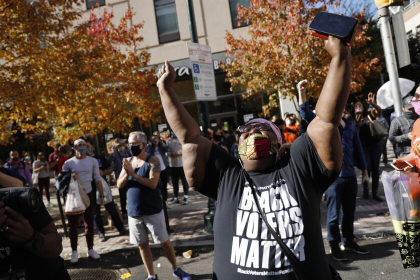 People celebrate in Philadelphia after the presidential election was called for Joe Biden and Kamala Harris on Nov. 7.