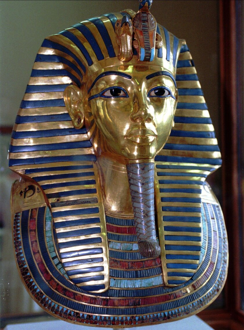 FILE - This July 1996 photo shows the mask of King Tutankhamun at the Egyptian Museum in Cairo. On Wednesday, Jan. 21, 2014, conservators at the museum say the blue and gold braided beard on the artifact was hastily glued back on with epoxy after it was detached during a cleaning. (AP Photo/Mohamed