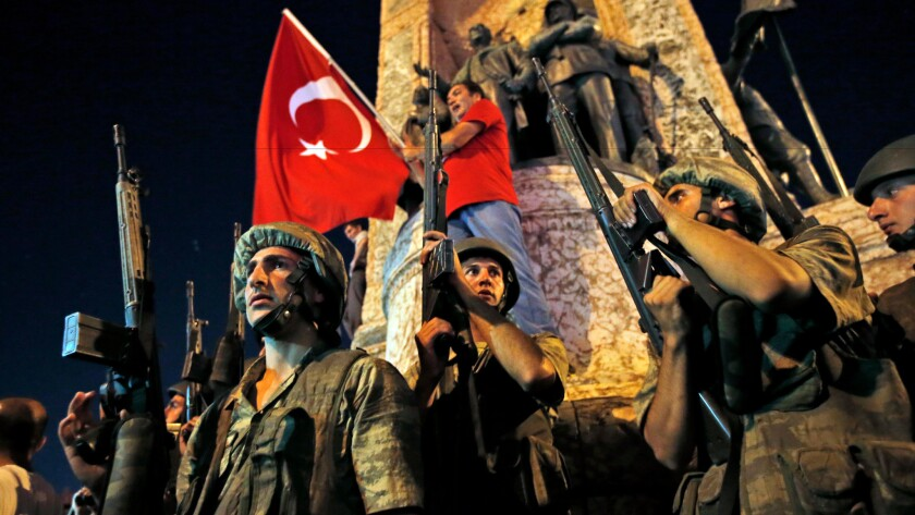 Turkish soldiers secure the area as supporters of President Recep Tayyip Erdogan protest in Istanbul's Taksim square on July 16, 2016.