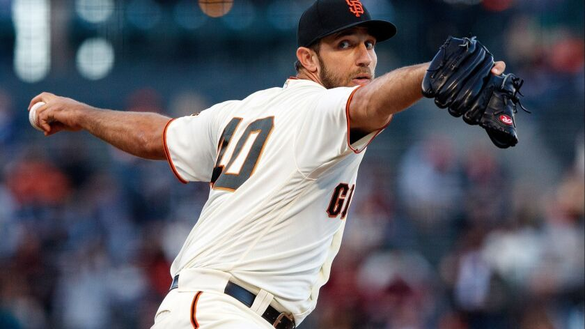 The Giants' Madison Bumgarner pitches against the San Diego Padres during the first inning at AT&T Park on June 21, 2018 in San Francisco, California.