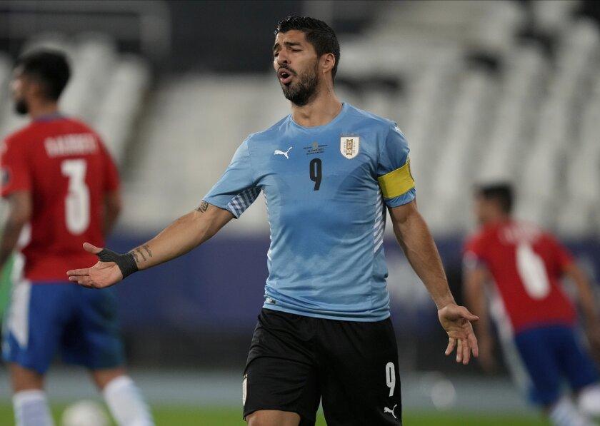 Uruguay's Luis Suarez gestures during a Copa America soccer match against Paraguay at Nilton Santos stadium in Rio de Janeiro, Brazil, Monday, June 28, 2021. (AP Photo/Ricardo Mazalan)