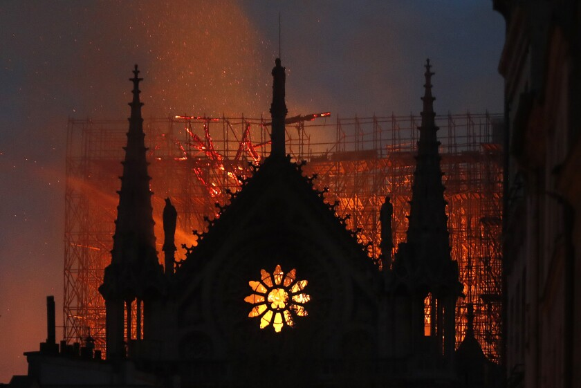 Flames and smoke rose from Notre Dame Cathedral as it burned in Paris on Monday. French President Emmanuel Macron said Tuesday that he wants to see the 12-century cathedral rebuilt within five years.