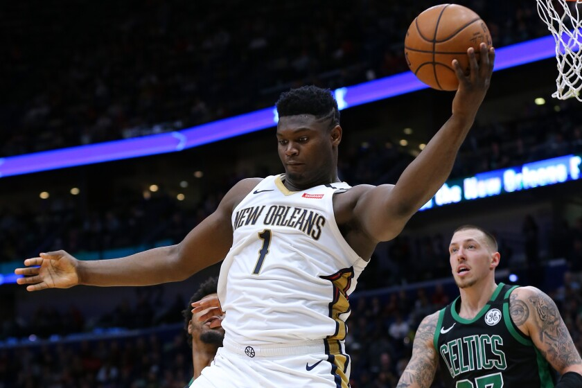 Pelicans forward Zion Williamson grabs a rebound during a game against the Celtics on Jan. 26, 2020.