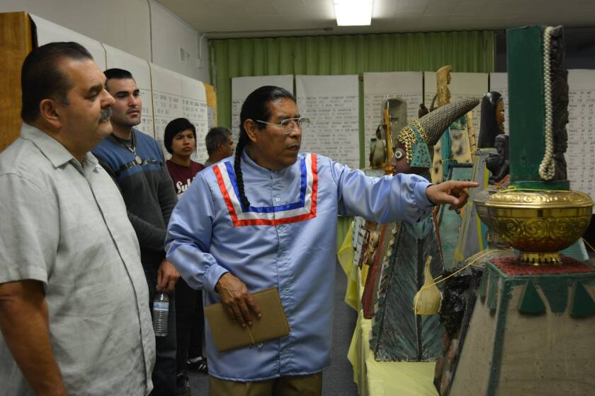 David Vazquez, center, hosted a Nahuatl exhibition in 2017 at the Episcopal Church of the Messiah in Santa Ana.