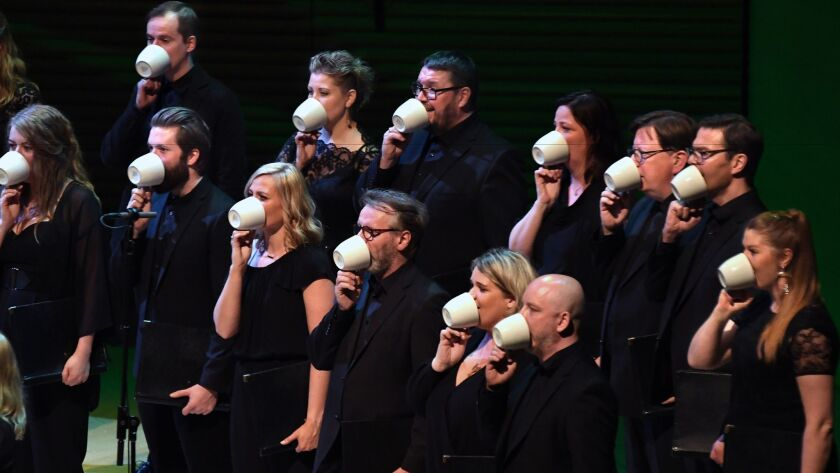 The choir sang into teacups at the Green Umbrella program at the L.A. Phil's Reykjavik Festival.