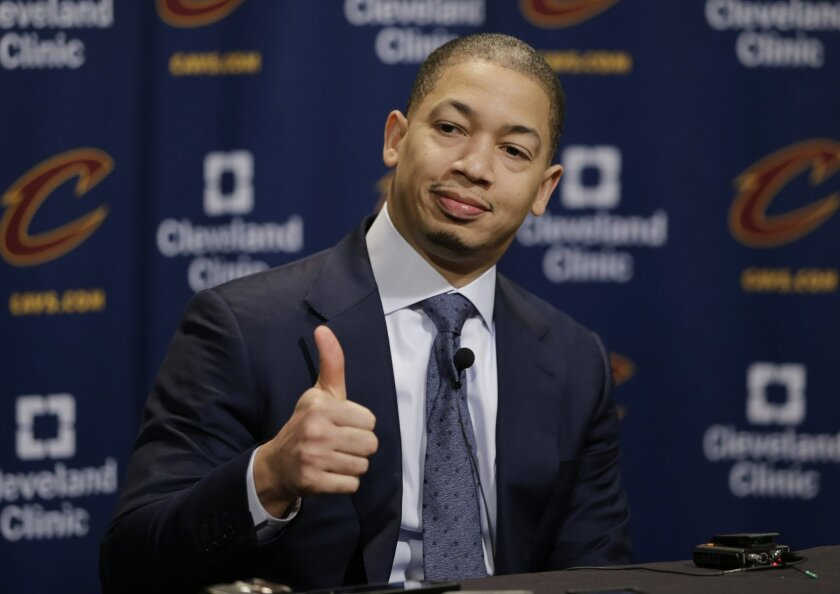 Cleveland Cavaliers head coach Tyronn Lue gives a thumbs up during a news conference before an NBA basketball game between the Chicago Bulls and the Cleveland Cavaliers, Thursday, Feb. 18, 2016, in Cleveland. The Cavaliers found a coveted wing shooter before the trading deadline. To get him, though