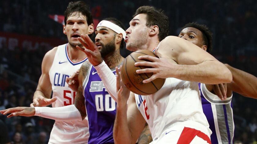 Clippers forward Danilo Gallinari drives to the basket against Sacramento Kings guard Buddy Hield in the second quarter on Wednesday at Staples Center.