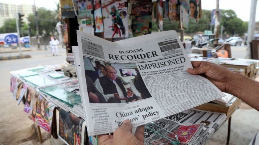 Pakistani newspapers carry front page news of the arrest of former Prime Minister Nawaz Sharif on July 14, 2018.