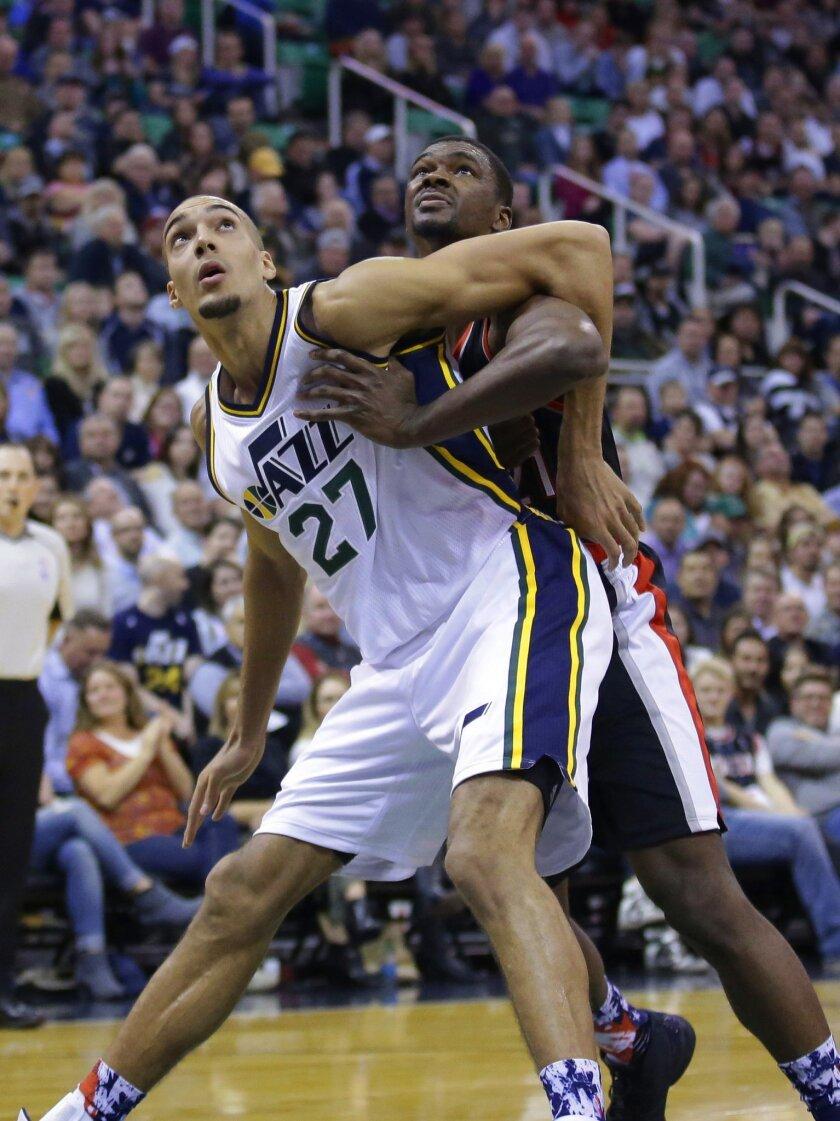 Utah Jazz center Rudy Gobert (27) and Portland Trail Blazers forward Noah Vonleh, rear, battle for position in the second quarter during an NBA basketball game Wednesday, Nov. 4, 2015, in Salt Lake City. (AP Photo/Rick Bowmer)