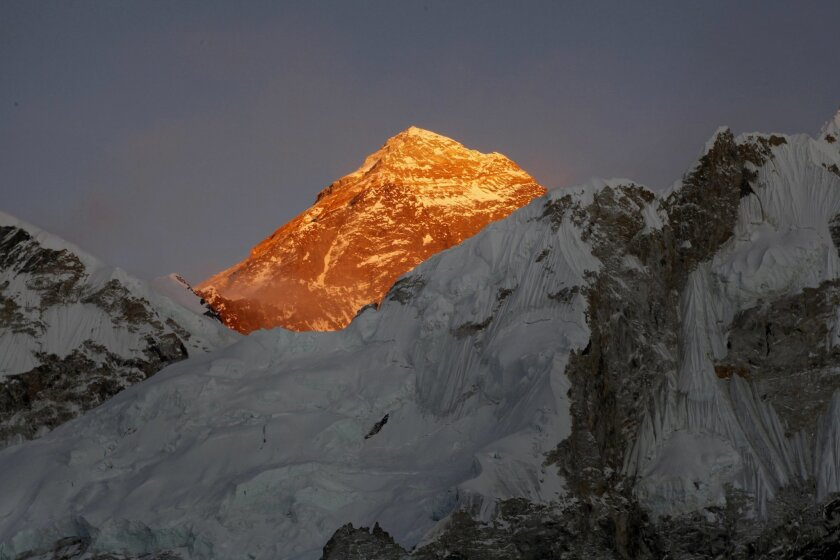 FILE - In this Nov. 12, 2015, file photo, Mt. Everest is seen from the route to Kalapatthar in Nepal. Climbers on Friday found the body of one of two Indians who went missing last week near the top of Mount Everest, while a helicopter brought back the body of an Australian woman who died on the mou