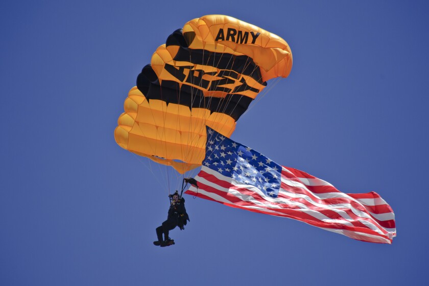 """A U.S. Army parachutist with the Golden Knights parachute team approaches his landing July 13, 2019, at the """"Mission Over Malmstrom"""" open house event on Malmstrom Air Force Base, Montana."""
