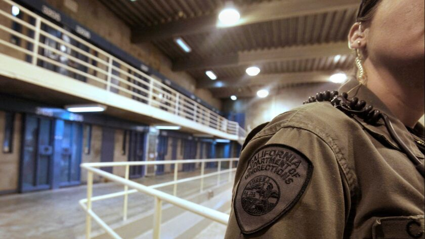 FILE - This Aug. 17, 2011 file photo shows a correctional officer in one of the housing units at Pel