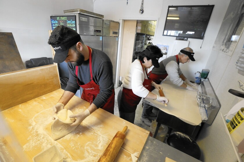 The dumplings are made from scratch by Sarkes, left, and his parents Evelina and Grant Yegiazaryan at the Monta Factory in Pasadena.