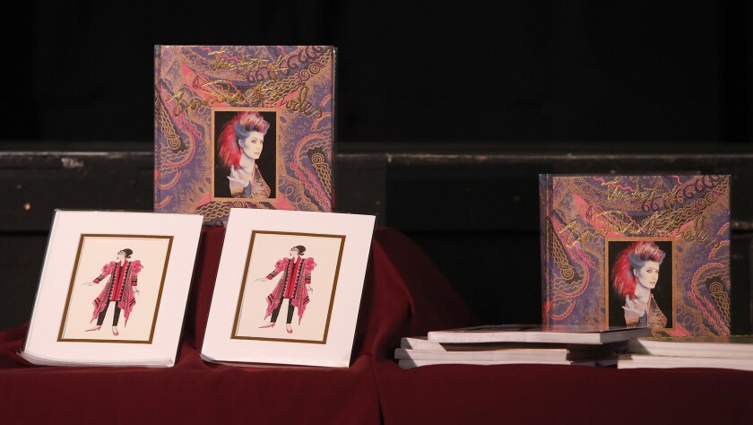 Design prints and albums on display during as British fashion designer Zandra Rhodes speaks at Hunti