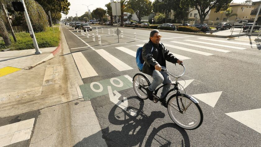 Los Angeles, CA - MARCH 5, 2019 Cyclists navigate the west bound lanes of a new temporary and contr
