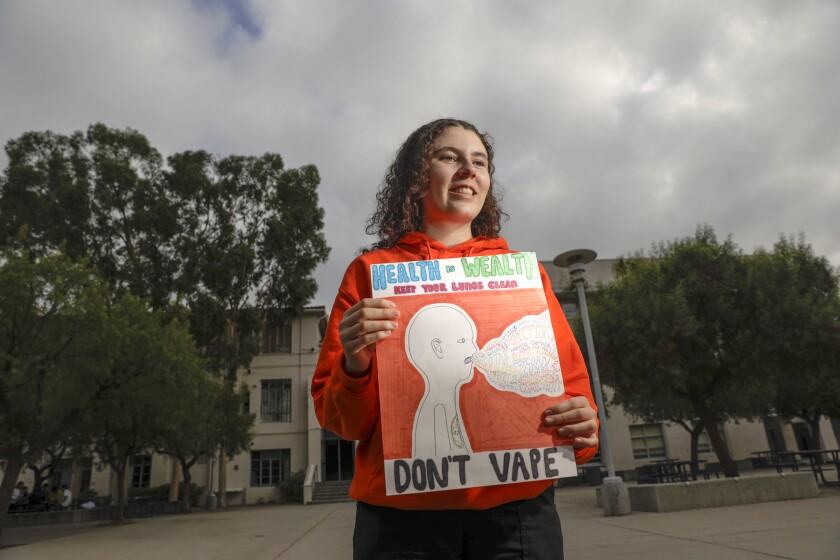 Crescenta Valley High School student Lucy Levine with her anti-vaping poster