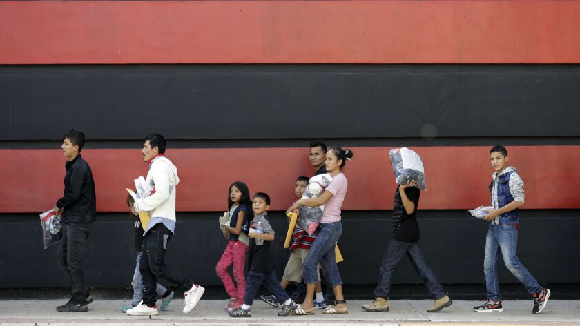 Immigrant families on their way to a respite center after they were processed and released by U.S. Customs and Border Protection on Sunday in McAllen, Texas.