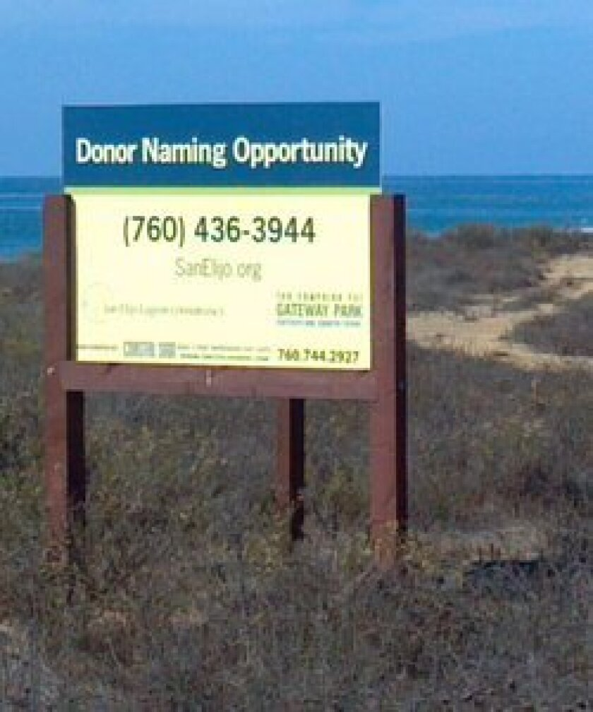 A new sign is installed at Gateway Park—the coastal open space between Cardiff-by-the-Sea and Solana Beach along Scenic Highway 101. For 20 years, commercial development threatened these pristine coastal views, wildlife buffer, and habitat for native plants and animals adjacent to San Elijo Lagoon.
