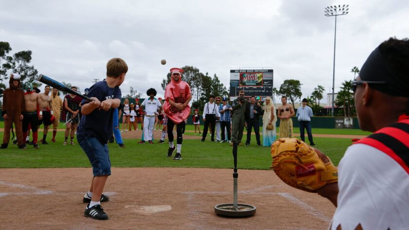 A young boy zeroes in on a pitch during the San Diego State baseball team's annual Halloween scrimmage at Tony Gwynn Stadium.