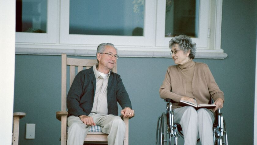 Man and woman at assisted living facility