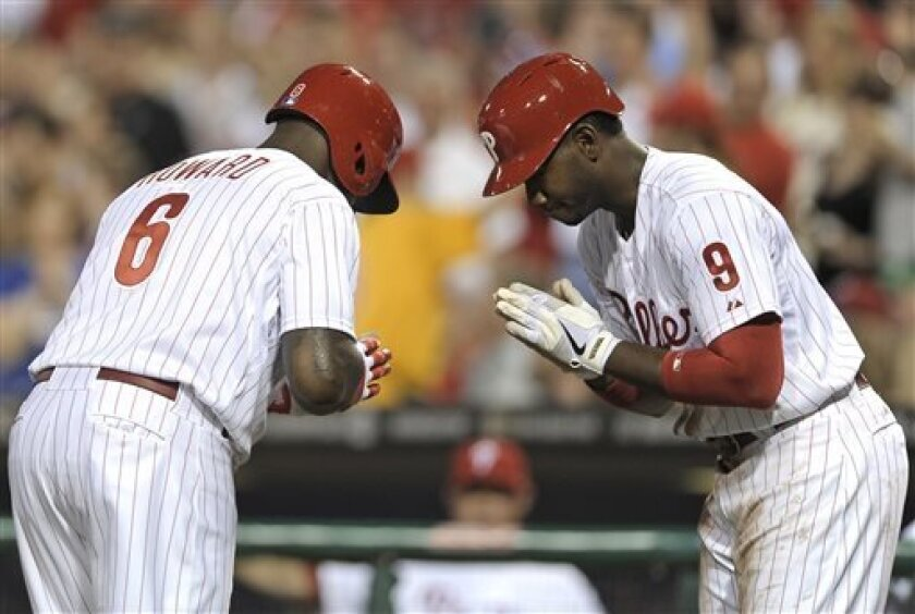 Philadelphia Phillies' Ryan Howard (6) celebrates with Domonic Brown after Howard hit a solo home run in the third inning of a baseball game against the New York Mets, Tuesday, April 9, 2013, in Philadelphia. (AP Photo/Michael Perez)