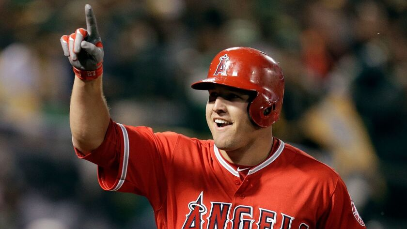 The Angels' Mike Trout celebrates after hitting a two-run home run against Oakland on Monday.