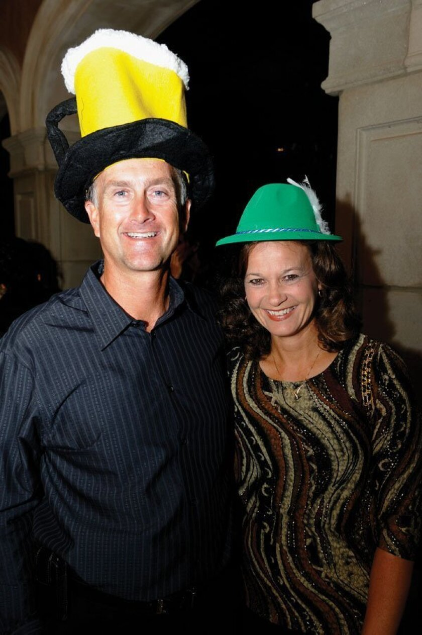 """Tim and Cindy Collins were among those who participated in Rancho Santa Fe Youth Soccer's """"Soctoberfest: Beer, Brat and Bretzel,"""" held Oct. 23 at the Cielo Club to benefit the club's Academy and Attack programs. Photos by Jon Clark"""