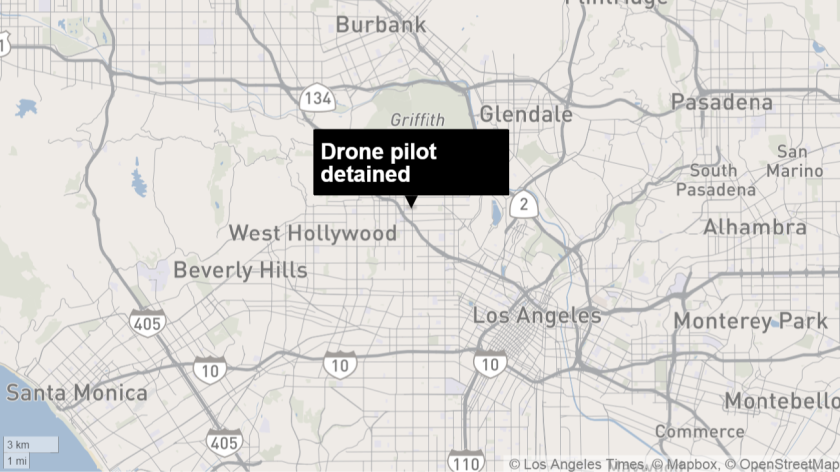 Police detained a man they say was flying a drone near a police helicopter.