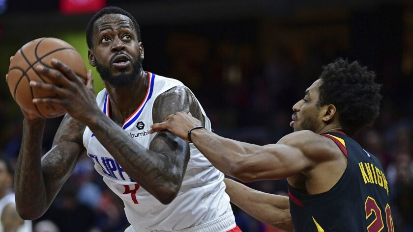 Los Angeles Clippers' JaMychal Green goes to the basket against Cleveland Cavaliers' Brandon Knight