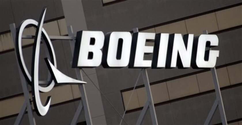 FILE - The Boeing Company logo is seen on the property in El Segundo, Calif., in this Jan. 25, 2011 file photo. Boeing is expected to announce third-quarter earnings later Wednesday Oct. 23, 2013. (AP Photo/Reed Saxon, File)
