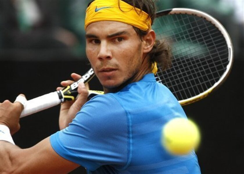 Rafael Nadal of Spain returns the ball to David Ferrer of Spain during their final match at the Rome Masters tennis tournament in Rome, Sunday, May 2, 2010. (AP Photo/Pier Paolo Cito)