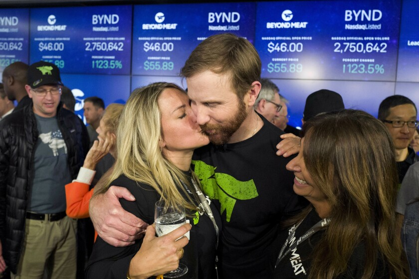 Tracy Brown kisses her husband, Ethan Brown, at the Nasdaq stock exchange