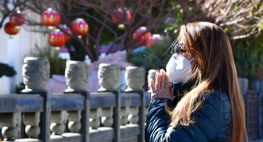 A woman prays on the first day of the Lunar New Year.