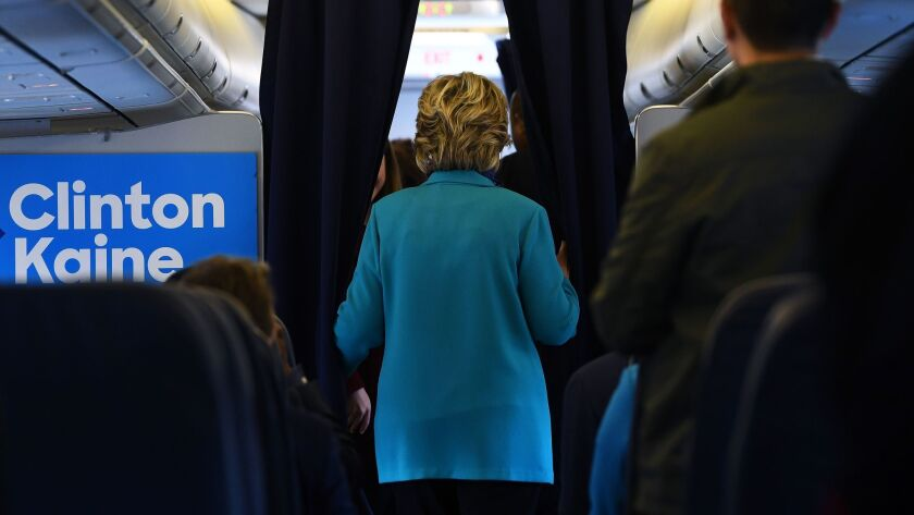 Hillary Clinton boards her plane on Saturday for a flight to Florida.