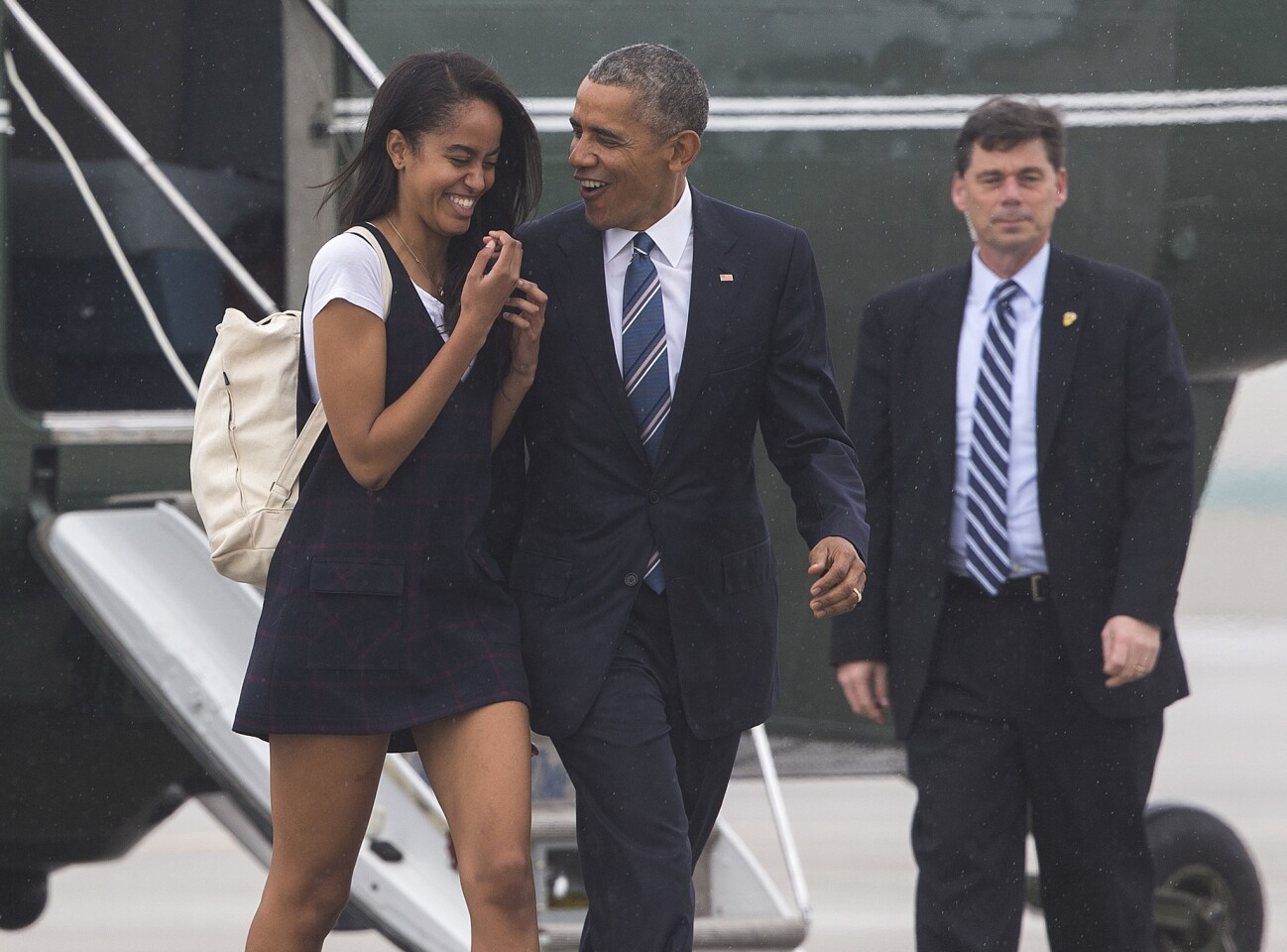 President Obama and daughter Malia walk across the tarmac to board Air Force One at LAX.