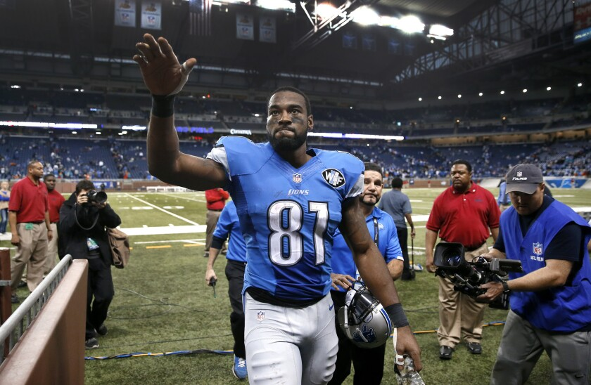 Detroit wide receiver Calvin Johnson waves to fans after a game against Miami on Nov. 9, 2014.