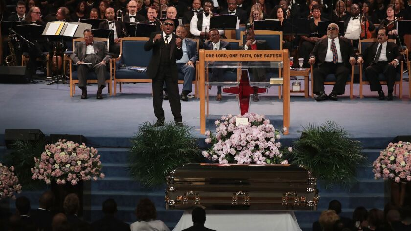 Ron Isley performs within view of Franklin's casket.