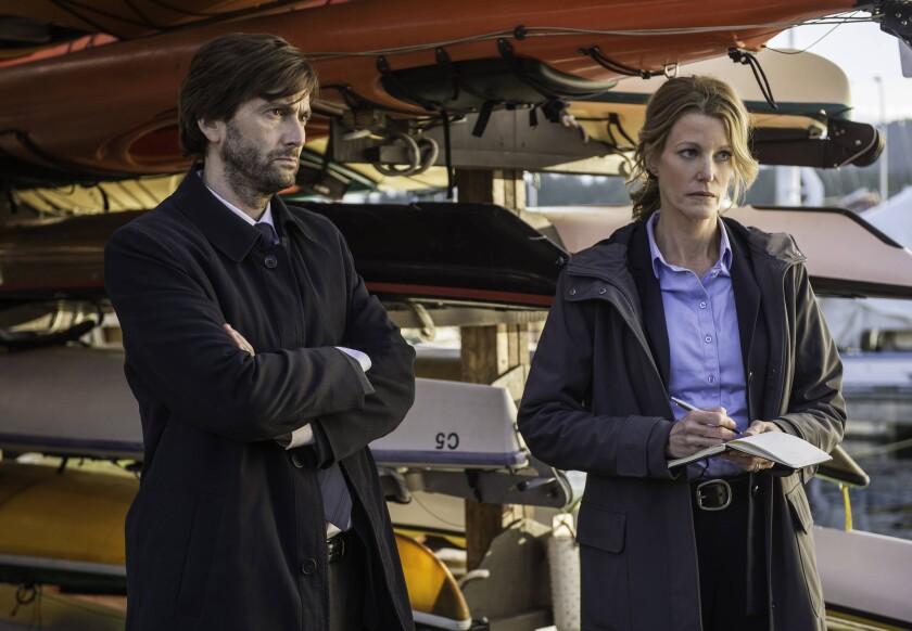 """David Tennant as Det. Emmett Carver and Anna Gunn as Det. Ellie Miller in a scene from """"Gracepoint."""""""