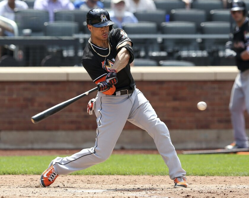 Miami Marlins' Giancarlo Stanton hits his second home run during the sixth inning of the baseball game against the New York Mets at Citi Field, Wednesday, July 6, 2016 in New York. (AP Photo/Seth Wenig)