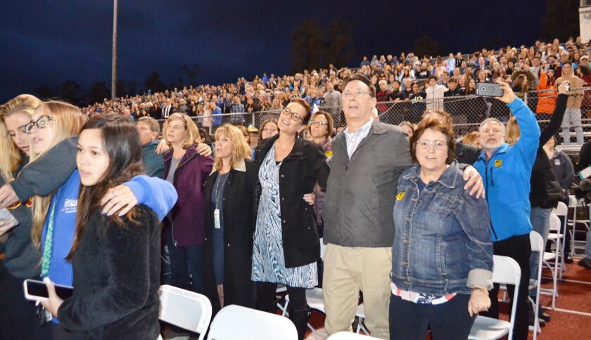 More than 4,000 community members wrapped arms around one another to show of unity during a vigil in Poway on April 29, 2019.