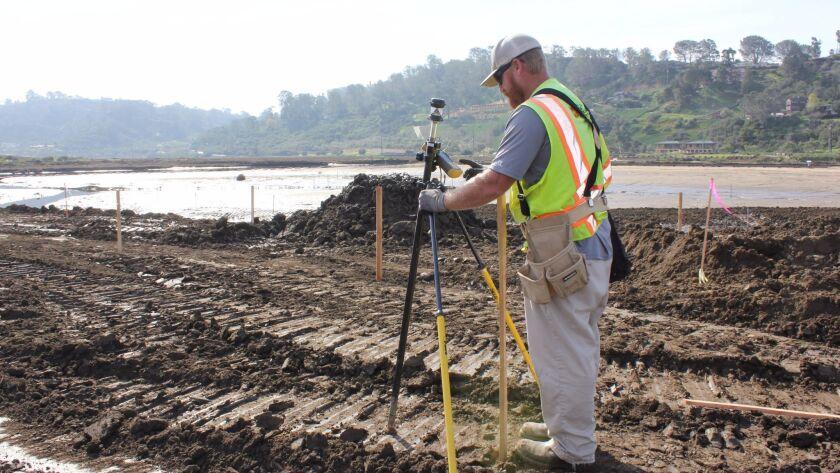 Sam Craig, an engineer with Marathon Construction Corp., surveys the restoration project area.