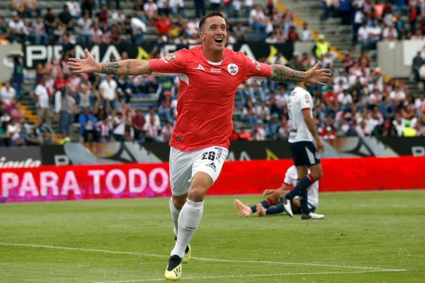 MÉXICO FÚTBOL TORNEO APERTURA:MEX100. Argentine player Leonardo Ramos, from Lobos BUAP, celebrates his score against Guadalajara on Sunday Oct. 21, 2018, during the match corresponding to the 13th day of the Mexican soccer tournament, held at the University Olympic Stadium, in the city of Puebla Mexico. EPA-EFE/Hilda Rios/FILE