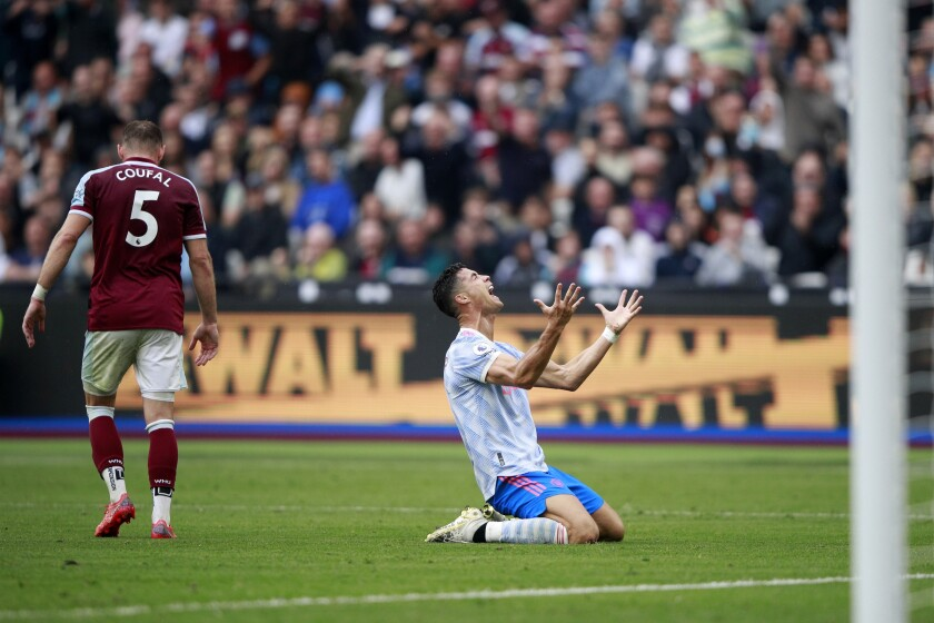 Manchester United's Cristiano Ronaldo reacts after he failed to score a goal during the English Premier League soccer match between West Ham United and Manchester United at the London Stadium in London, England, Sunday, Sept. 19, 2021. (AP Photo/Ian Walton)
