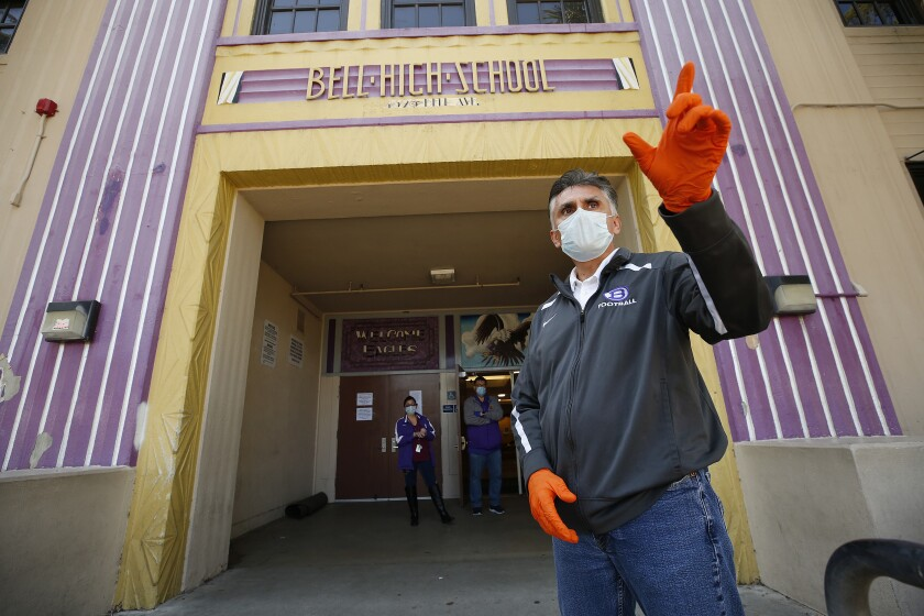 Principal Rafael Balderas stands outside Bell High School, which was closed because of the COVID-19 pandemic.