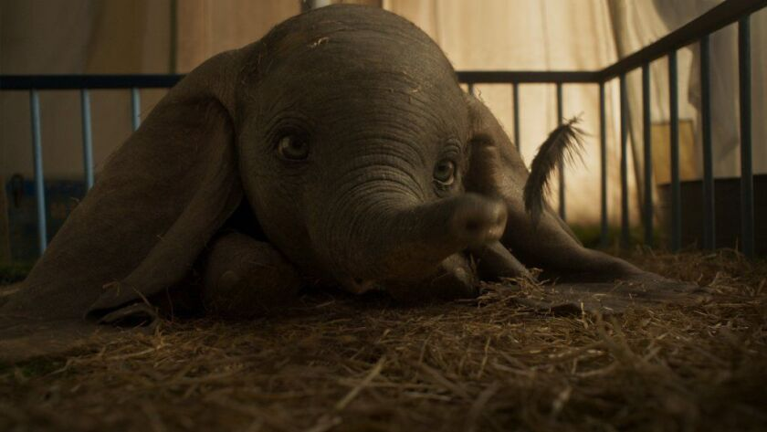 """Dumbo and his beloved feather in Tim Burton's live action re-imagining of Disney's animated classic """"Dumbo."""""""